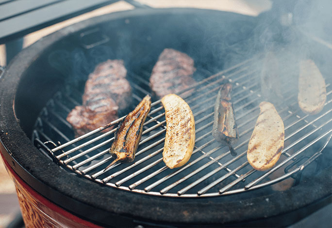 A photo showing food being grilled on a Kamado Joe - One of the Best Kamado Grills