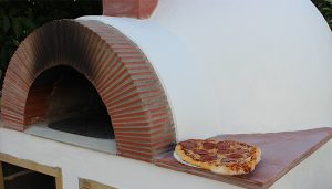 A photo of the outside of our homemade pizza oven.