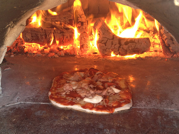 A Photo Of Pizza Cooking In Our Homemade Wood Fired Oven